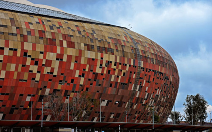 Security, officials and the media are busy setting up at FNB Stadium for the memorial service. Picture: AFP.