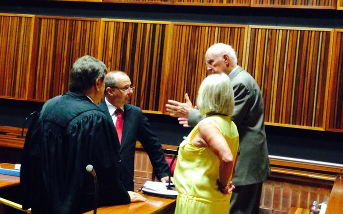 Bob Hewitt talks to his legal team during a break on 11 February 2015. Picture: Masego Rahlaga/EWN.