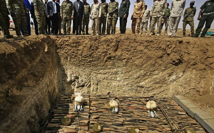 Members of the Sudanese army stand as weapons that were collected from Sudanese citizens are destroyed in the Hajar al-Asal base, the Nile River State, 200 kilometres north of the capital Khartoum, on 29 September 2020. Picture: AFP.
