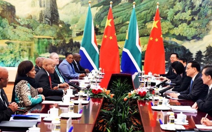 President Jacob Zuma with members of his delegation during a bilateral meeting with China Premier Li Keqiang at the Great Hall of the People in the People's Republic of China. Picture: GCIS.