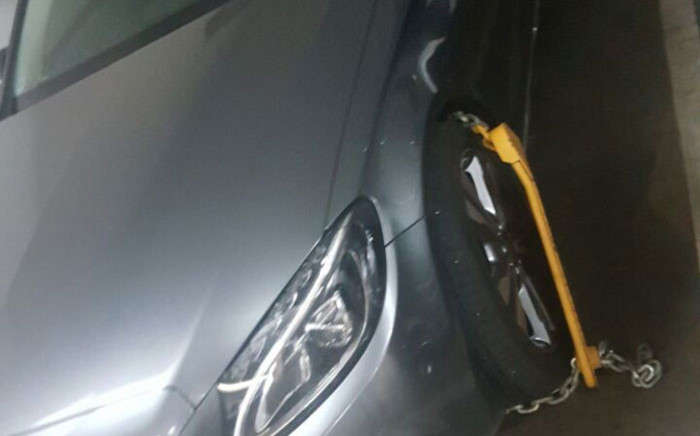 Brigadier Leonora Phetle's vehicle is wheel-clamped after she refused to hand over the keys in the wake of her suspension. Picture: Supplied