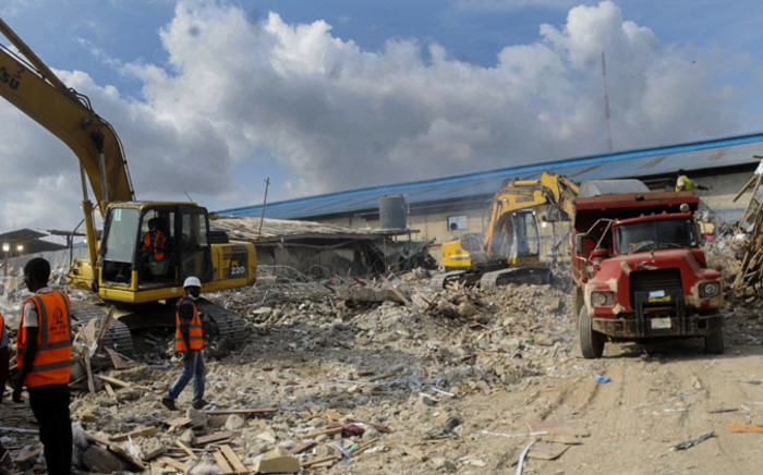 FILE: Nigerian rescue workers searching through rubble from the collapsed guesthouse at the Synagogue Church of All Nations in Lagos on 16 September 2014. Picture: EPA.