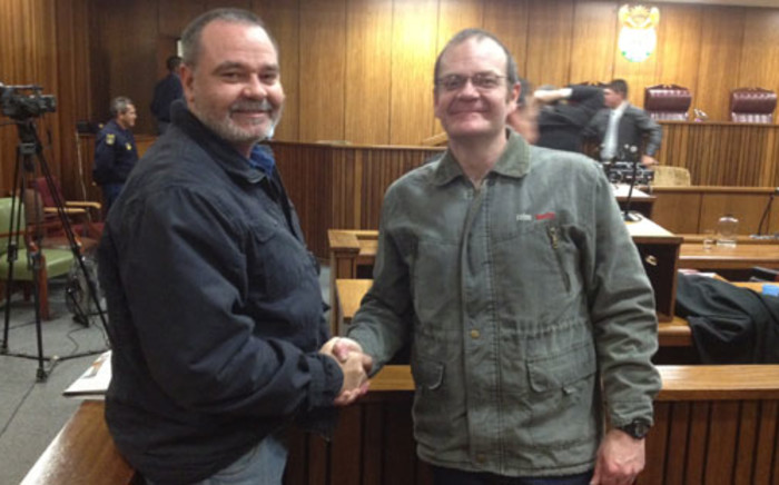 Boeremag brothers Mike and Andre du Toit congratulate each other after Judge Eben Jordaan convicted Andre of high treason. Picture: Barry Bateman/EWN.