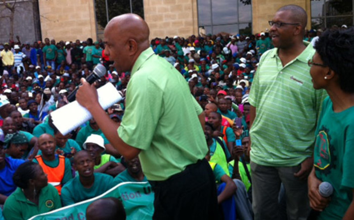 FILE: Amcu President Joseph Mathunjwa addresses hundreds of the union members during a march outside Impala Platinum's headquarters on 27 March 2014. Picture: Gis Nicolaides/EWN.