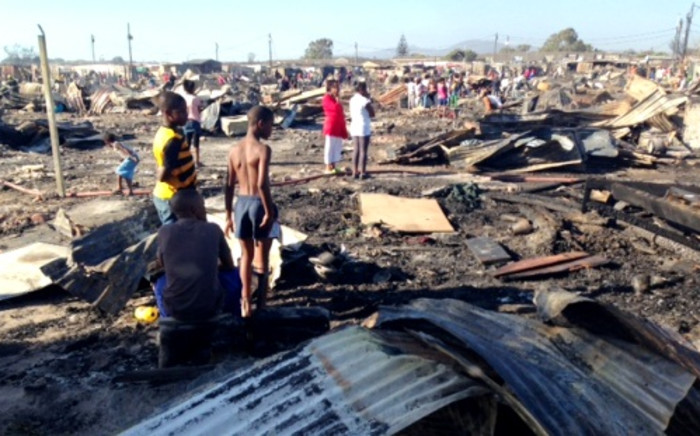 FILE: Children and their parents are seen walking around the burnt-out remains of their Valhalla Park homes after a massive blaze. Picture: Rahima Essop/EWN.