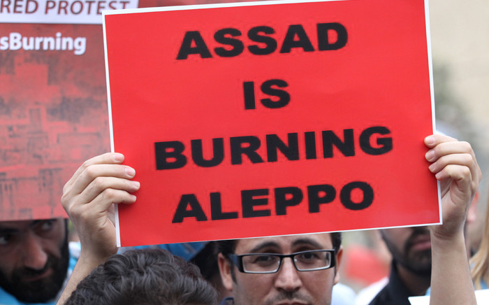 A protester holds a banner as he takes part in a demonstration in front of United Nations offices in Beirut in solidarity with the civilians of the northern Syrian city of Aleppo and against the regime of the Syrian president, on 1 May, 2016. Picture: AFP.