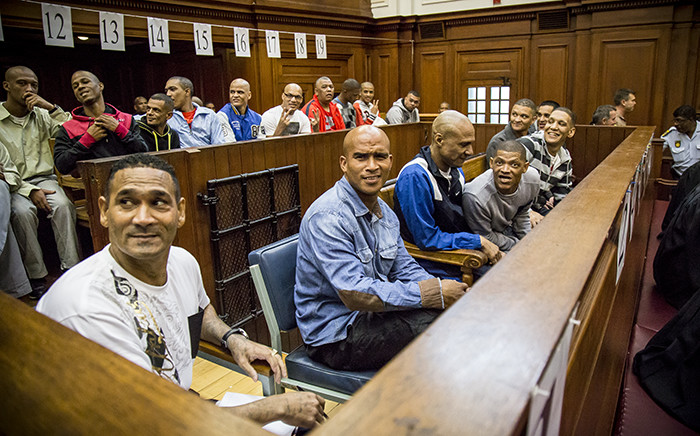 FILE: An alleged leader of the 28s gang, George 'Geweld' Thomas (L) and his 16 co-accused in court. Picture: Thomas Holder/EWN.