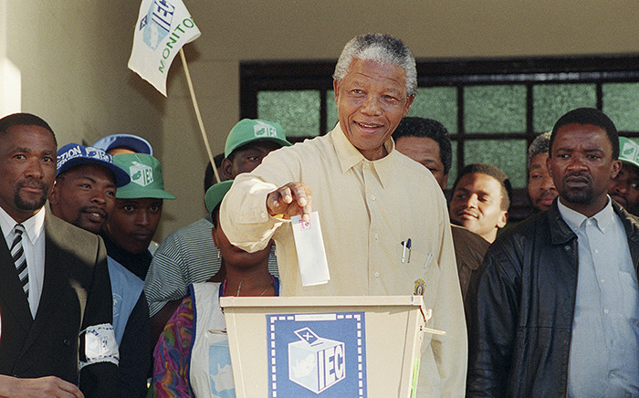 FILE: Nelson Mandela smiles broadly 27 April 1994 in Oshlange, near Durban, as he casts his historic vote during South Africa's first democratic and all-race general elections. Picture: AFP.