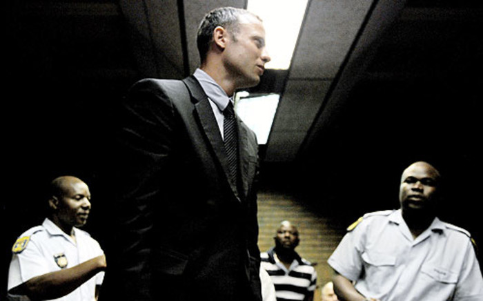 Oscar Pistorius appears in the Pretoria Magistrates Court after he shot and killed his girlfriend Reeva Steenkamp. Picture: AFP