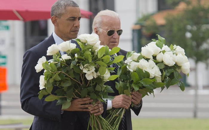 US President Barack Obama and Vice President Joe Biden place flowers for the victims of the mass shooting at a gay nightclub Sunday at a memorial at the Dr. Phillips Center for the Performing Arts in Orlando, Florida, 16 June, 2016. Picture: AFP.