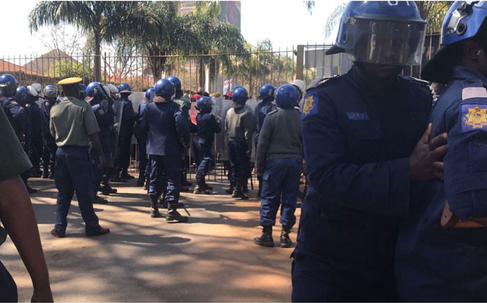There is a standoff between police and Movement for Democratic Change (MDC) Alliance supporters outside the gates of the electoral commission's results centre in Harare. Picture: Masechaba Sefularo/EWN