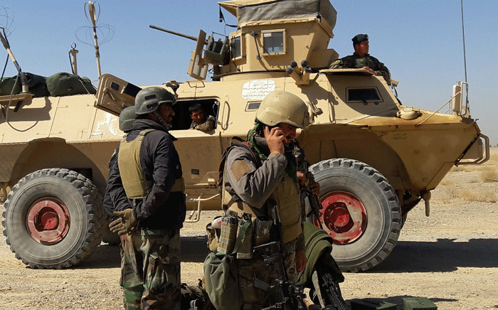 FILE: Afghan security forces stand near an armoured vehicle during ongoing fighting between Afghan security forces and Taliban fighters in the Busharan area on the outskirts of Lashkar Gah, the capital city of Helmand province 5 May 2021. Picture: Sifatullah Zahidi / AFP
