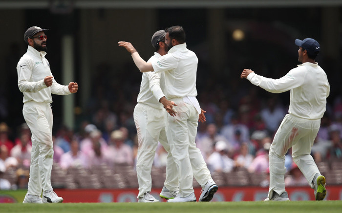 India players celebrate a wicket during their match against Australia. Picture: @BCCI/Twitter