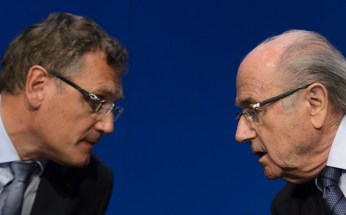 FILE: Fifa president Sepp Blatter speaks with Fifa's suspended Secretary General Jerome Valcke during a press conference on 30 May, 2015 in Zurich after being re-elected during the Fifa Congress. Picture: AFP.