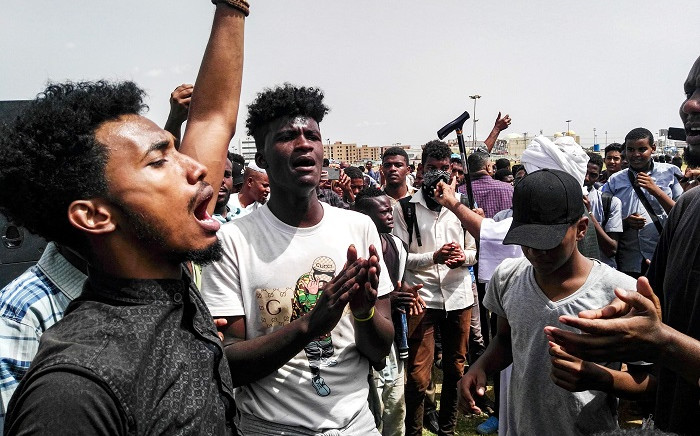 Sudanese protesters chant slogans and wave national flags as they march in the capital Khartoum's Green Square on 18 July 2019, as they honour comrades killed in the months-long protest movement that has rocked the country. Picture: AFP
