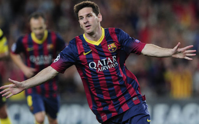Barcelona's Argentinian forward Lionel Messi celebrates after scoring during the UEFA Champions league football match against Ajax Amsterdam at Camp Nou stadium in Barcelona on 18 September 18, 2013. Picture: AFP