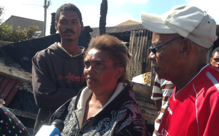 Distraught family members of the five people killed when their shack caught alight in Lotus River on 2 February 2014. Picture: Lauren Isaacs/EWN.