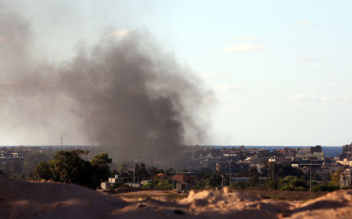 FILE: Smoke billows from buildings after an aerial strike targeting Islamic State (IS) group positions in Sirte. Picture: AFP