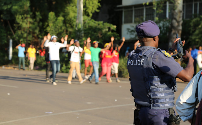 Police stand by with rubber bullets as the #FeesMustFall students march through Pretoria. Picture: Christa Eybers/EWN