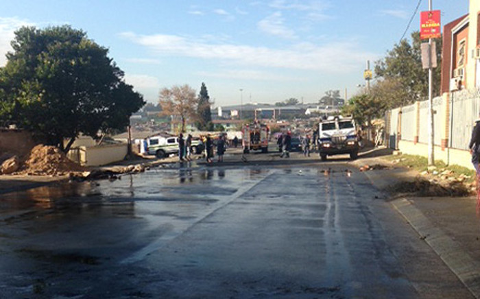 Cleaning under way in Alexandra where overnight protests saw resident burn ANC offices and a local clinic on 9 May 2014. Picture: Mia Lindeque/EWN.