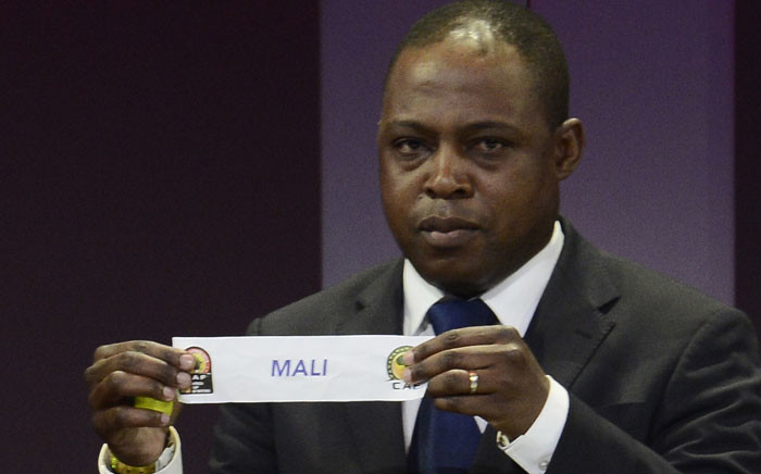 FILE: Former football player Kalusha Bwalya of Zambia shows the paper of Mali during the final draw of the Africa Cup of Nations. Picture: AFP.