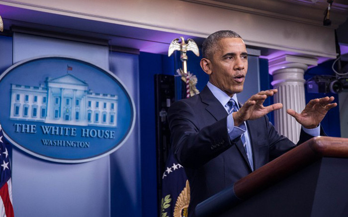 US President Barack Obama holds a year-end press conference in the Brady Press Briefing Room of the White House in Washington, DC, 16 December, 2016. Picture: AFP.
