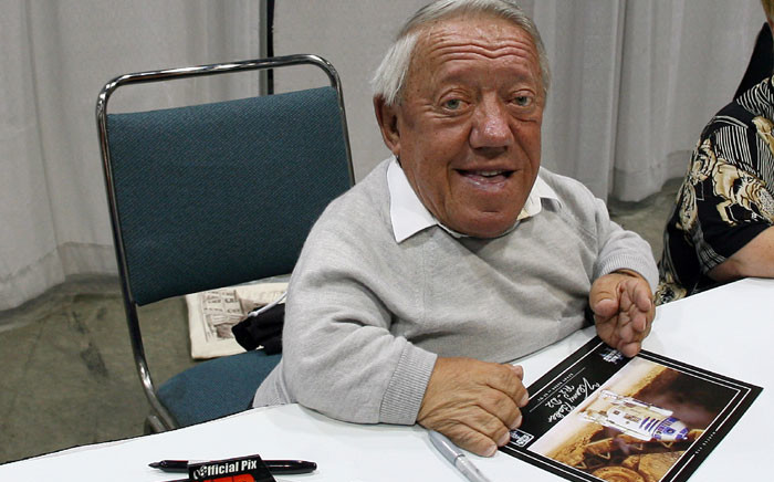 "This file photo taken on May 25, 2007 shows Star Wars actor Kenny Baker signs autographs during the opening day of ""Star Wars Celebration IV"" in Los Angeles. Kenny Baker, the British actor who starred as plucky robot R2-D2 in the ""Star Wars"" movies, died on August 13, 2016, his niece told local media. Picture: AFP."