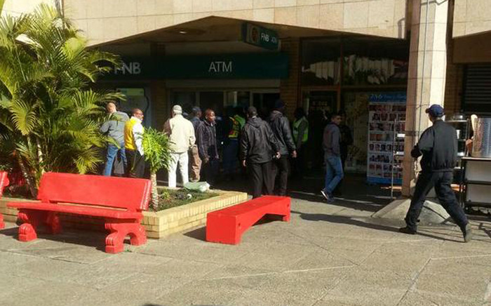 Police gather at the scene out FNB bank following a robbery at Oriental Plaza in Fordsburg on 3 July 2015. @crimeairnetwork.
