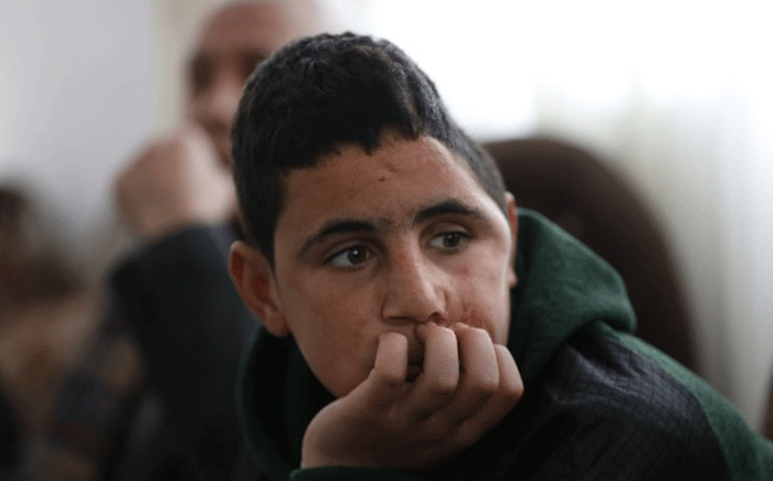 Palestinian Mohammed al-Tamimi, 15, sits at his family home in the West Bank city of Ramallah on February 27, 2018. Picture: AFP.