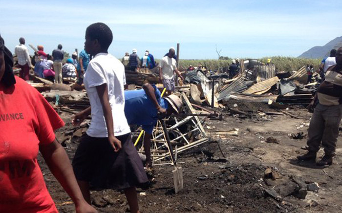 Two people died and at least 4,000 others have been left displaced following Masiphumelele shack fire on 29 November 2015. Picture: Shamiela Fisher/EWN.