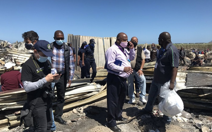 Cape Town Mayor Dan Plato on 18 December 2020 visited Masiphumelele after a massive fire raged through part of the informal settlement on 17 December 2020 leaving more than 1,000 homes destroyed. Picture: Kevin Brandt/EWN