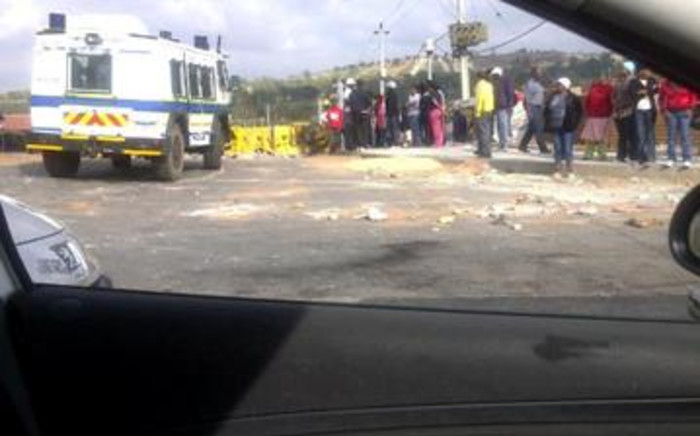 Police keep a close eye on New Canada Road after early morning protests. 15 November 2011 Picture: Molemo Mabapa/IWN
