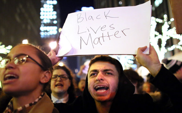 Demonstrators walk together during a protest on 3 December 2014 in New York. Protests began after a Grand Jury decided to not indict officer Daniel Pantaleo. Picture: AFP.
