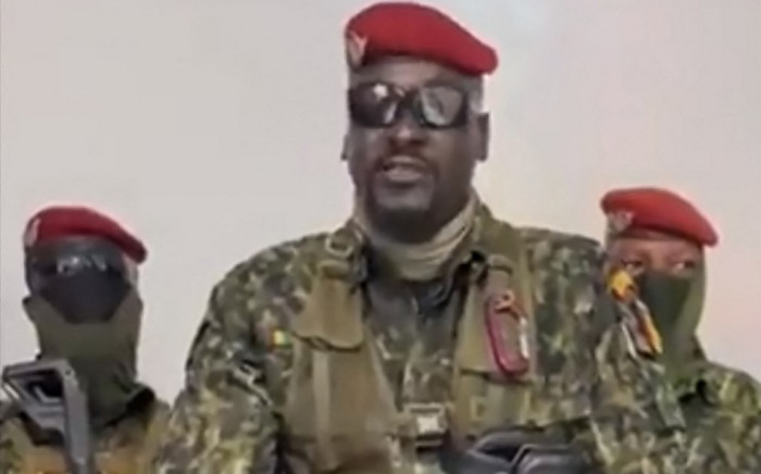 A screengrab taken from footage sent to AFP by a military source on 5 September 2021 shows Guinean Colonel Doumbouya delivering a speech following the capture of the President of Guinea Conakry and the dissolution of the government during a coup d'etat in Conakry on 5 September 2021. Picture: AFP