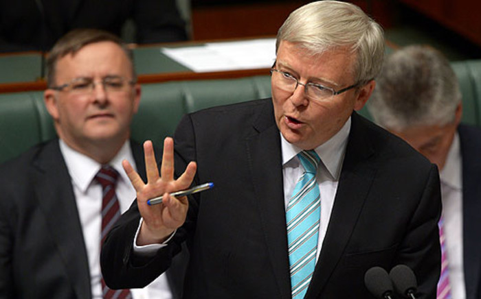 FILE: Former Australian Prime Minister Kevin Rudd (C). Picture: AFP.