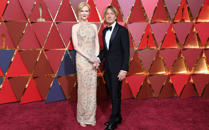 """Nominee for Best Supporting Actress """"Lion"""" Nicole Kidman arrives with her husband Keith Urban on the red carpet for the 89th Oscars on 26 February, 2017 in Hollywood, California. Picture: AFP."""