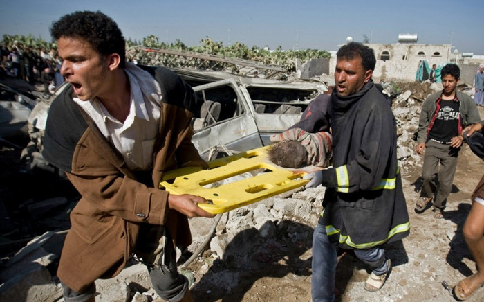 FILE: A screebgran picture shows people carrying an injured child in Yemen after Saudi-led air strikes in an ongoing war between the two countries.
