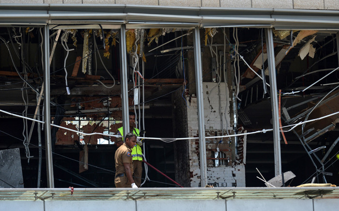 Sri Lankan police stand at the site of an explosion in a restaurant area of the luxury Shangri-La Hotel in Colombo on 21 April 2019. Picture: AFP
