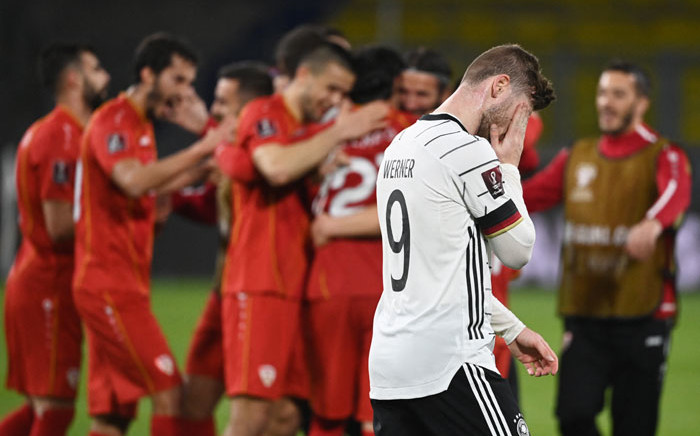 North Macedonia players celebrate a win as Germany forward Timo Werner walks past after their Fifa World Cup Qatar 2022 qualification football match in Duisburg, western Germany on March 31, 2021. Picture: Ina Fassbender/AFP