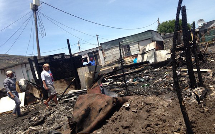 FILE. Two people died and at least 4,000 were left displaced following Masiphumelele shack fire on 29 November 2015. Picture: Shamiela Fisher/EWN.
