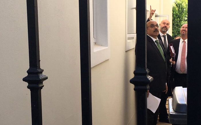 Western Cape High Court Judge Siraj Desai & defence lawyer Pieter Botha look at the side of the de Zalze home where three van Breda family members were murdered. Picture: Giovanna Gerbi/EWN.
