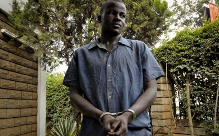 FILE: Sydney Nsubuga, alleged killer of gay activist David Kato, was paraded in front of Journalists at the Ugandan media centre in Kamapala on 3 February 2011. Police disputed the theory of a hate crime and contributed the murder of David Kato to a disagreement between Mr. Kato and Enock Nsubuga about money and other issues. Picture: AFP.