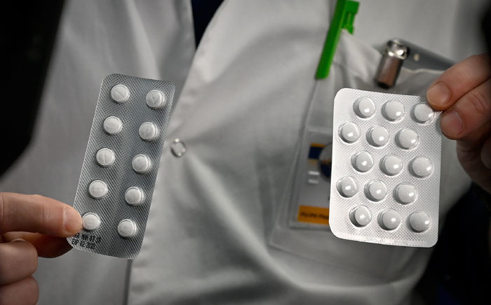FILE: In this file photo taken on 26 February 2020, medical staff shows o at the IHU Mediterranee Infection Institute in Marseille, packets of a Nivaquine, tablets containing chloroquine and Plaqueril, tablets containing hydroxychloroquine, drugs that have shown signs of effectiveness against coronavirus. Picture: AFP