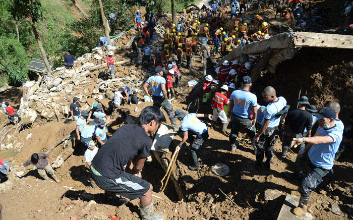 Rescuers dig on the remains of a building which was swift away by a landslide burying dozens of residents during heavy rains at the height of Typhoon Mangkhut in Itogon town, Benguet province north of Manila on 18 September 2018. Picture: AFP