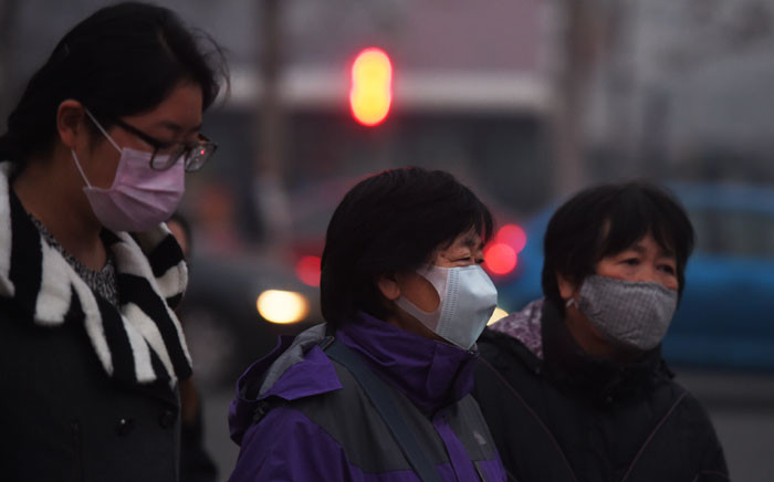 FILE: Chinese wear masks to avoid breathing in polluted air. Picture: AFP.