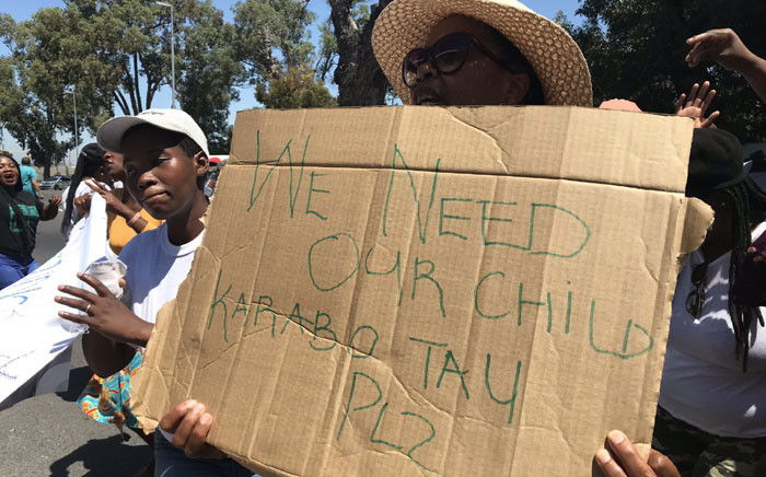A supporter of the missing child's family holds up a poster outside of court, calling for no bail for Karabo Tau. Tau received bail on 12 February 2020. Picture: Lauren Isaacs/EWN.
