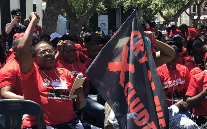 """Activists demonstrate outside Parliament ahead of their """"Real Jobs Summit"""" being held at a hall within the St George's Cathedral precinct on 24 February 2020. Picture: Kevin Brandt/EWN"""