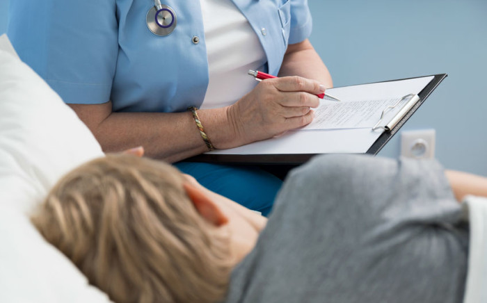 Medical doctor writes notes about patient. Image: 123rf.com