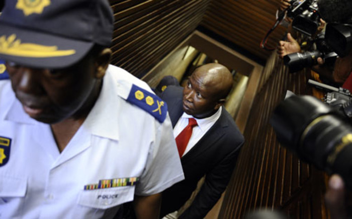 File: Julius Malema arrives at court on September 26, 2012 in Polokwane, charged with money laundering linked to public tenders. Picture: AFP
