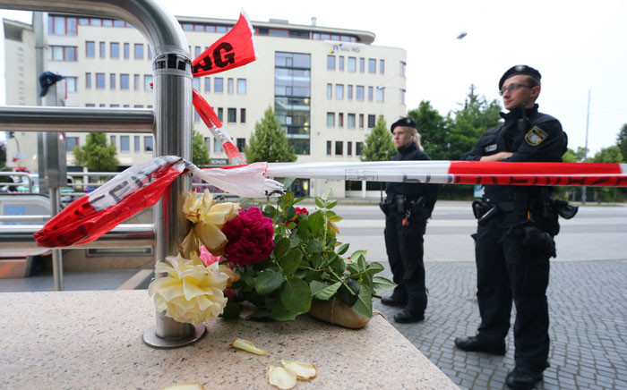 Policemen stand in front of a cordoned-off underground station near the Olympia-Einkaufszentrum shopping centre in Munich, southern Germany, on 23 July 2016, one day after the attack at the shopping centre in Munich. Picture: Karl-Josef Hildenbrand/dpa/ AFP.